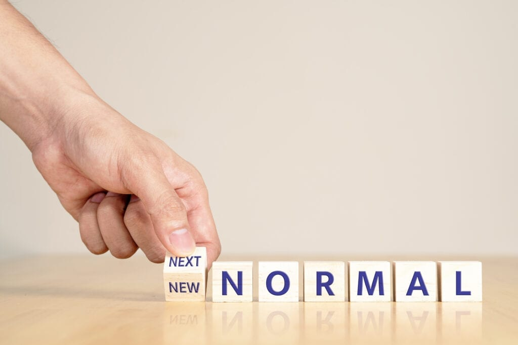 Man's hand with concept of new or next normal digital transform in industry business, disrupt from coronavirus, covid crisis impact to small business or SME. Turn to next normal in financial concept.
