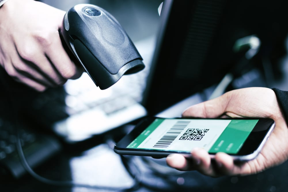 close up view of cashier scanning bar code on a phone