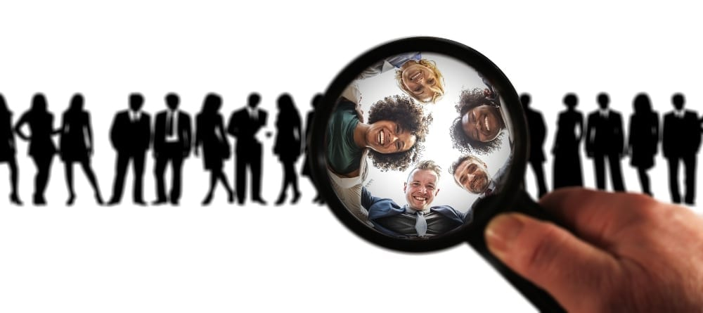 photo of people in a line with a magnifying glass highlighting some faces